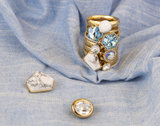 Melano Twisted Flower steentje goudkleurig  - Aquamarine_